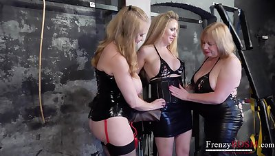 Three old lesbians are fucking each others cunts in the BDSM room
