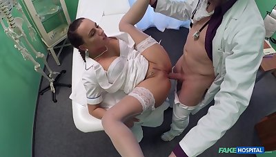 Aroused babe takes it in both holes during a doctor's exam