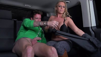 Sexy MILF with big tits gets fucked in a roomy van