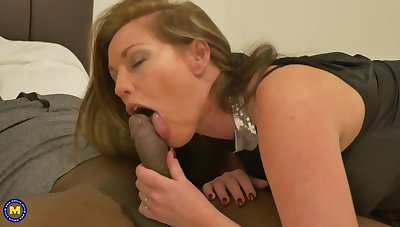Holly Kiss together with a handsome, black man are fucking in front of a hidden camera