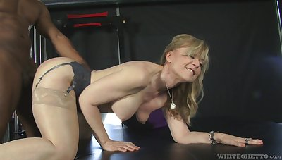 Fit fat bottomed GILF Nina Hartley cannot will not hear of a big black load of shit