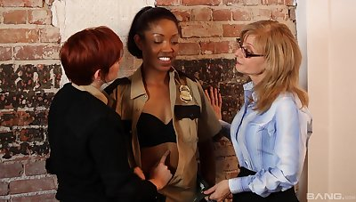 Interracial lesbian fucking on the table with blue Nina Hartley
